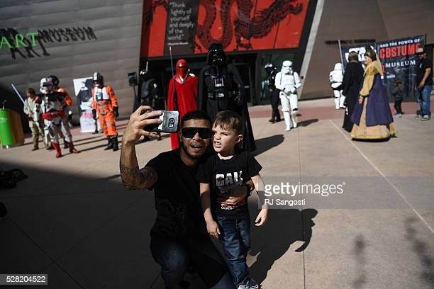 Gabriel Diaz, and his nephew Roman Diaz take a selfie outside the Denver Art Museum, May 04, 2016. The museum held a May the 4th Be With You event to...