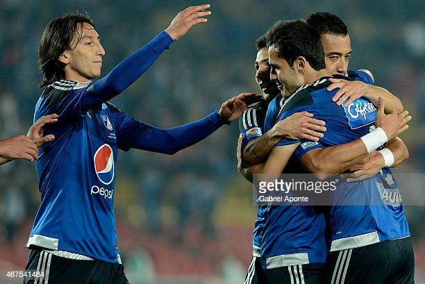Gabriel Diaz of Millonarios celebrates with teammates after scoring the fourth goal of his team during a match between Millonarios and Deportivo...
