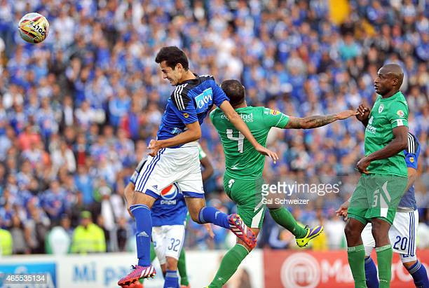 Gabriel Diaz of Millonarios heads the ball to score the first goal of his team during a match between Millonarios and La Equidad as part of eighth...