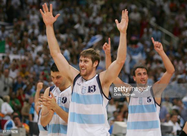 Gabriel Diego Fernandez Andres Nocioni and Emanuel Ginobili of Argentina celebrate defeating United States in the men's basketball semifinal game on...