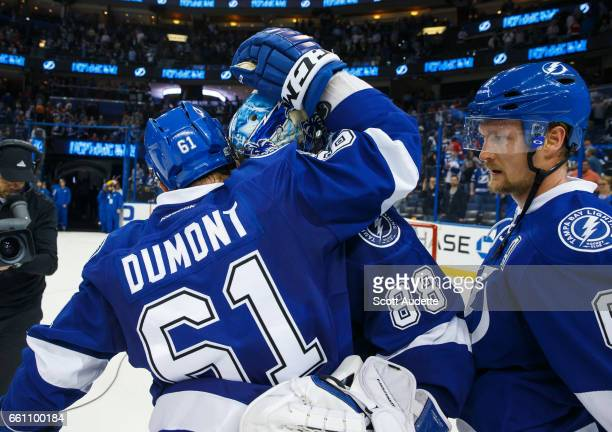 Gabriel Dumont and goalie Andrei Vasilevskiy of the Tampa Bay Lightning celebrate the win after the game against the Detroit Red Wings at Amalie...