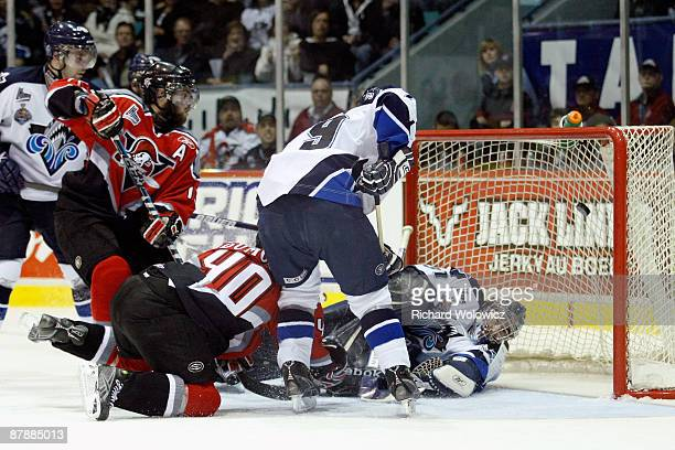 Gabriel Dumont of the Drummondville Voltigeurs scores the game-winning goal on Maxim Gougeon of the Rimouski Oceanic during the 2009 Mastercard...