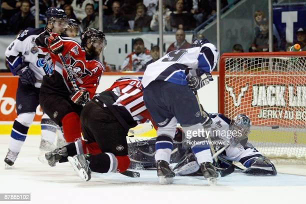 Gabriel Dumont of the Drummondville Voltigeurs scores the game-winning goal against Maxim Gougeon of the Rimouski Oceanic during the 2009 Mastercard...