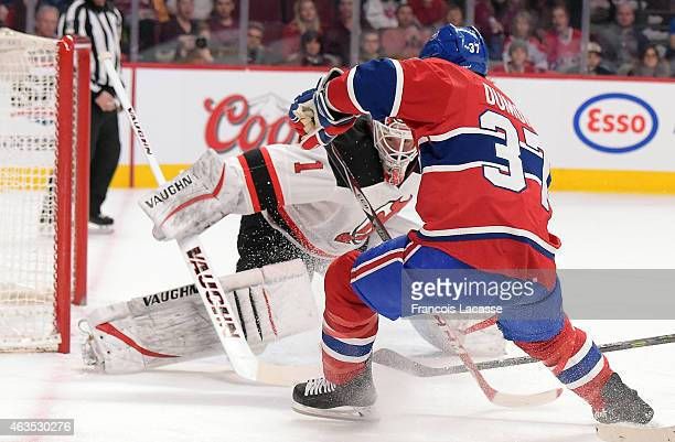 Gabriel Dumont of the Montreal Canadiens shoots against Keith Kinkaid of the New Jersey Devils in the NHL game at the Bell Centre on February 7 2015...