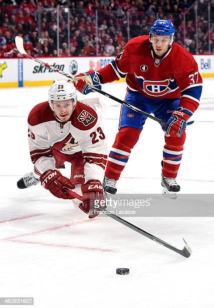 Gabriel Dumont of the Montreal Canadiens skates for the puck against Oliver EkmanLarsson of the Phoenix Coyotes in the NHL game at the Bell Centre on...