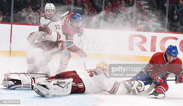 Gabriel Dumont of the Montreal Canadiens takes a shot on Louis Domingue of the Phoenix Coyotes in the NHL game at the Bell Centre on February 1 2015...