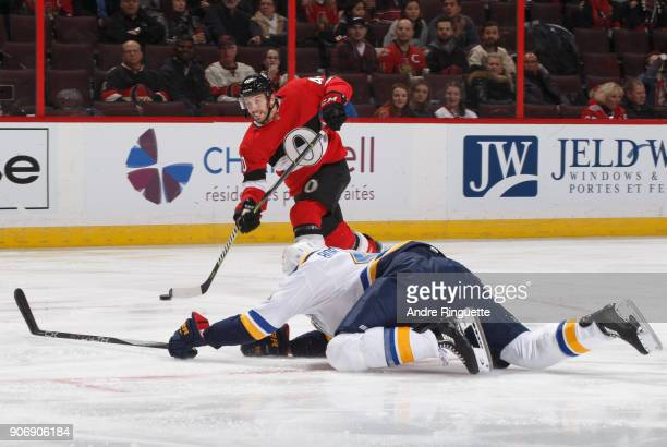 Gabriel Dumont of the Ottawa Senators breaks his stick on a slapshot as Robert Bortuzzo of the St Louis Blues dives to block the shot at Canadian...
