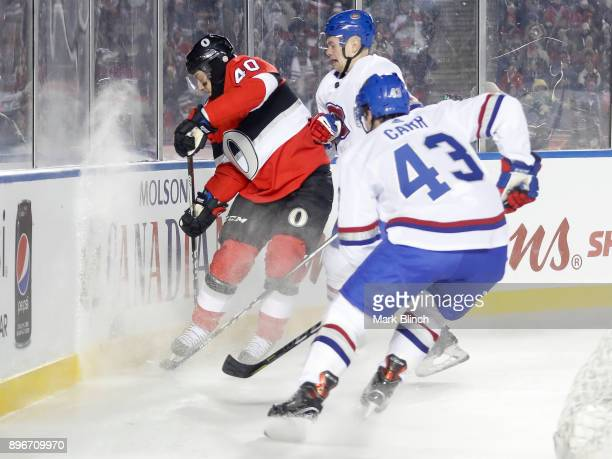 Gabriel Dumont of the Ottawa Senators protects the puck along the boards while being checked by Byron Froese of the Montreal Canadiens during the the...