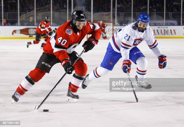 Gabriel Dumont of the Ottawa Senators skates against David Schlemko of the Montreal Canadiens in the 2017 Scotiabank NHL100 Classic at Lansdowne Park...