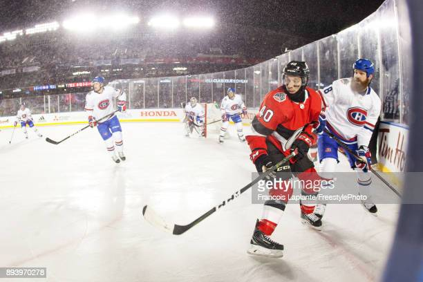 Gabriel Dumont of the Ottawa Senators skates against Jordie Benn of the Montreal Canadiens at the 2017 Scotiabank NHL 100 Classic at Lansdowne Park...