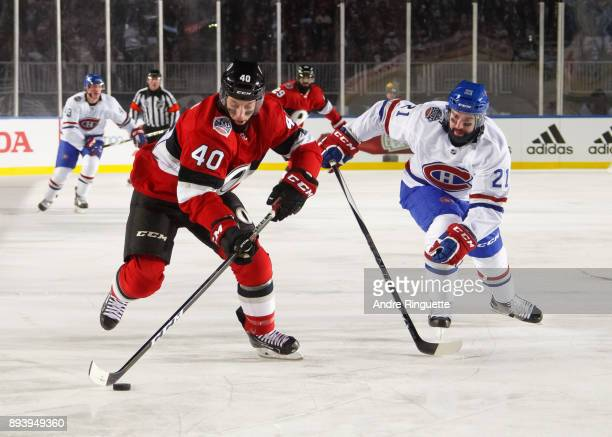 Gabriel Dumont of the Ottawa Senators skates with the puck against David Schlemko of the Montreal Canadiens during the first period of the 2017...