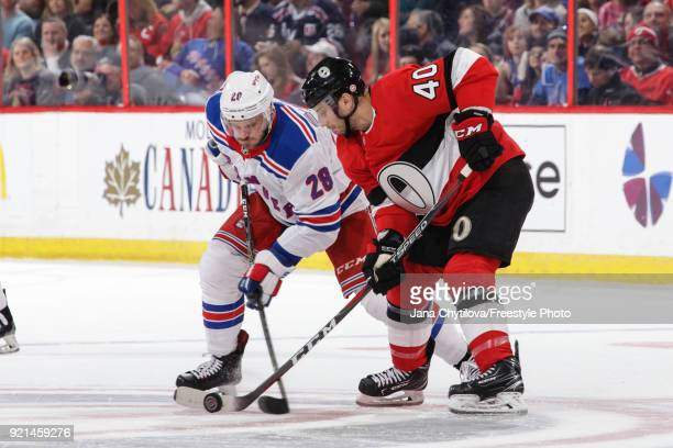 Gabriel Dumont of the Ottawa Senators takes a faceoff against Paul Carey of the New York Rangers at Canadian Tire Centre on February 17 2018 in...