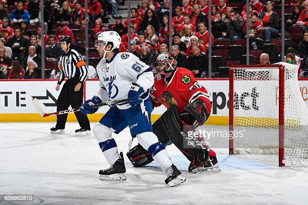 Gabriel Dumont of the Tampa Bay Lightning waits in position in front of goalie Corey Crawford of the Chicago Blackhawks in the second period at the...