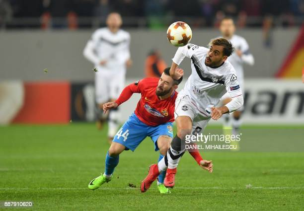 Gabriel Enache of Steaua Bucharest vies with Davide Mariani of Energy Investment Lugano during the UEFA Europa League group G football match FCSB...