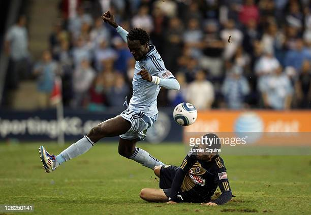 Gabriel Farfan of the Philadelphia Union attempts a slide tackle as Kei Kamara of Sporting Kansas City controls the ball during the game on September...