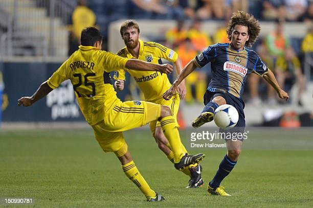 Gabriel Farfan of the Philadelphia Union kicks the ball away from Jairo Arrieta of the Columbus Crew at PPL Park on August 29 2012 in Chester...