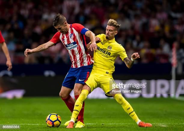 Gabriel Fernandez Arenas Gabi of Atletico de Madrid fights for the ball with Samuel Castillejo Azuaga Samu Castillejo of Villarreal CF during the La...