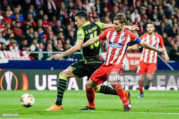 Gabriel Fernandez Arenas Gabi of Atletico de Madrid fights for the ball with Rodrigo Battaglia of Sporting CP during the UEFA Europa League quarter...