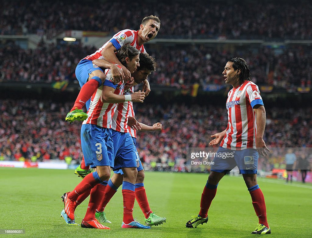 Gabriel Fernandez 'Gabi' (L), Felipe Luis (#3) and Radamel Falcao (R) of Club Atletico de Madrid celebrate after Atletico scored their opening goal during the Copa del Rey Final between Real Madrid CF and Club Atletico de Madrid at Estadio Santiago Bernabeu on May 17, 2013 in Madrid, Spain.