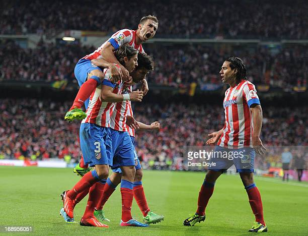 Gabriel Fernandez 'Gabi' Felipe Luis and Radamel Falcao of Club Atletico de Madrid celebrate after Atletico scored their opening goal during the Copa...