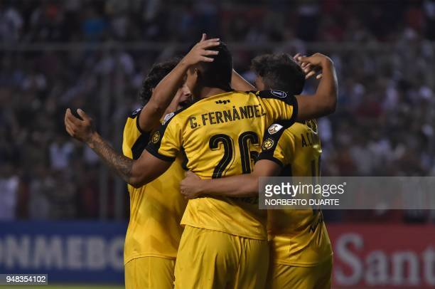 Gabriel Fernandez of Uruguay's Penarol celebrates with teammates after scoring against Paraguay's Libertad during their 2018 Libertadores Cup...