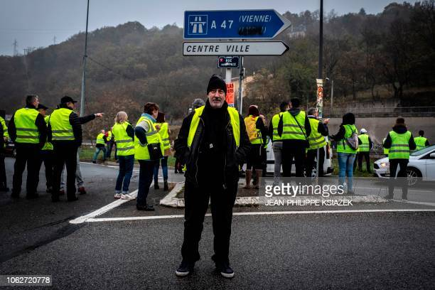 Gabriel Francois a boilermaker stand with other demonstrators wearing yellow vests during a protest against the rising of the fuel and oil prices on...