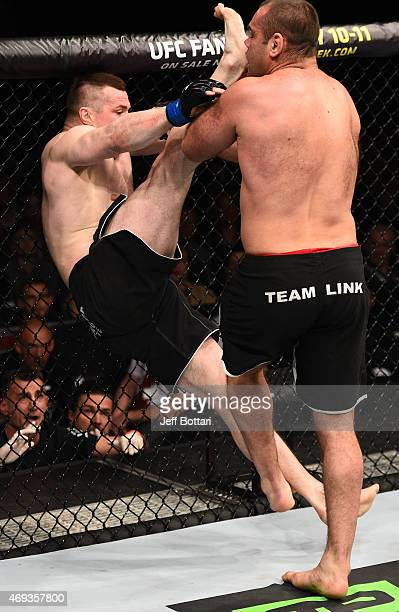Gabriel Gonzaga of Brazil takes down Mirko Cro Cop of Croatia in their heavyweight fight during the UFC Fight Night event at the Tauron Arena on...