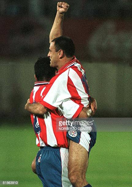 Gabriel Gonzalez and Francisco Arce celebrate the first goal of the Paraguayan Selection 02 September 2000 in Asuncion Paraguay The Paraguayan...