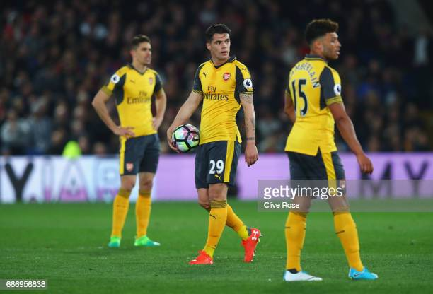 Gabriel Granit Xhaka and Alex OxladeChamberlain of Arsenal look dejected during the Premier League match between Crystal Palace and Arsenal at...
