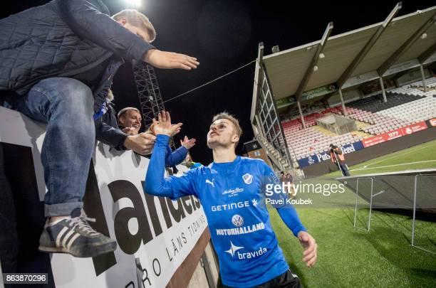 Gabriel Gudmundsson of Halmstad BK celebrates after the victory with the fans during the Allsvenskan match between Orebro SK and Halmstad BK at Behrn...