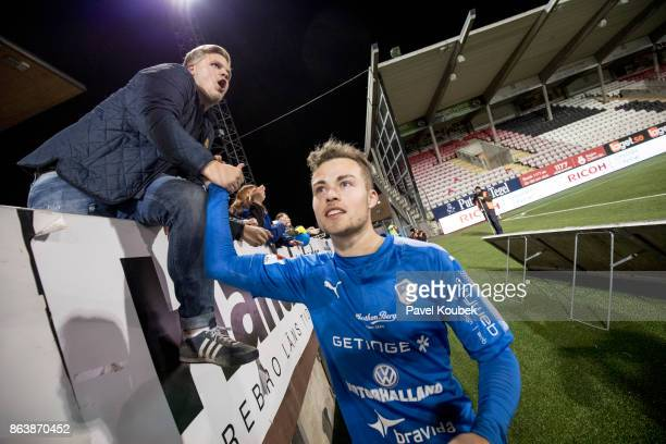Gabriel Gudmundsson of Halmstad BK celebrates with fans after the victory during the Allsvenskan match between Orebro SK and Halmstad BK at Behrn...