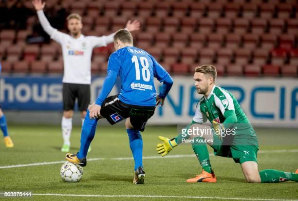 Gabriel Gudmundsson of Halmstad BK , Oscar Jansson of Orebro SK during the Allsvenskan match between Orebro SK and Halmstad BK at Behrn Arena on...
