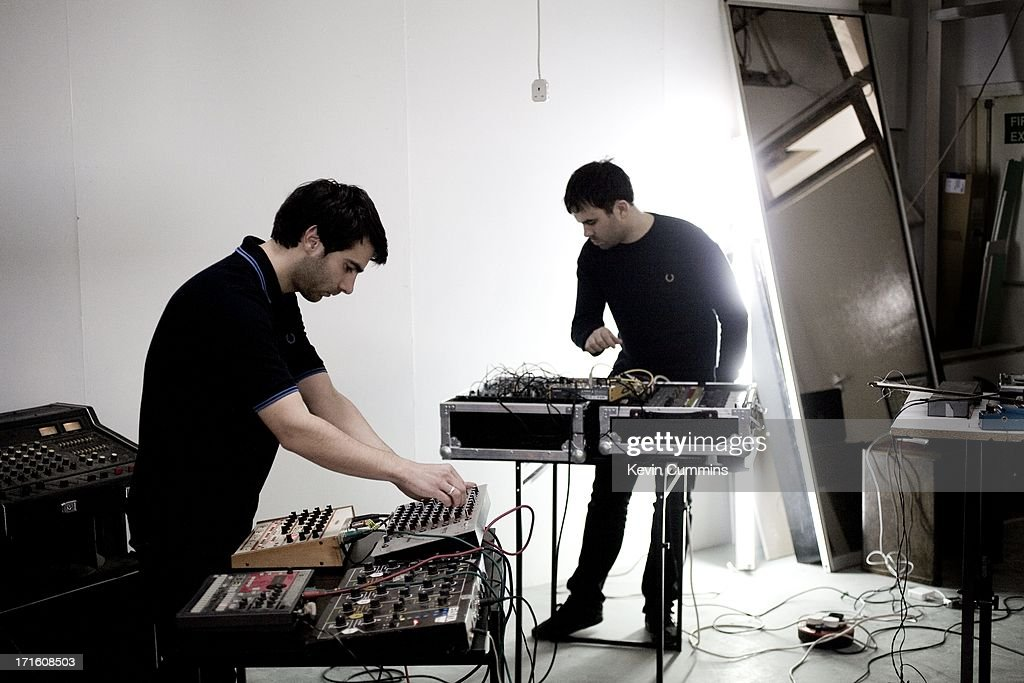 Gabriel Gurnsey And Dominic Butler Of Electronic Rock Band Factory Floor Play Synthesizers At A Rehearsal