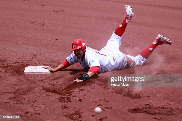 Gabriel Gutierrez of Diablos Rojos tagged out during a playoffs match between Vaqueros Laguna and Diablos Rojos as part of the Mexican Baseball...