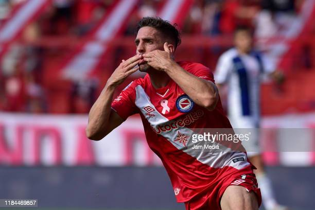 Gabriel Hauche of Argentinos Juniors celebrates after scoring the first goal of his team during a match between Argentinos Juniors and Talleres as...