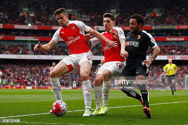 Gabriel Hector Bellerin of Arsenal compete for the ball against Ikechi Anya of Watford during the Barclays Premier League match between Arsenal and...