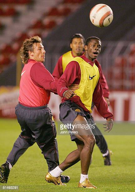 Gabriel Heinze and Louis Saha of Manchester United in action during a training session ahead of the UEFA Champions League match between Sparta Prague...