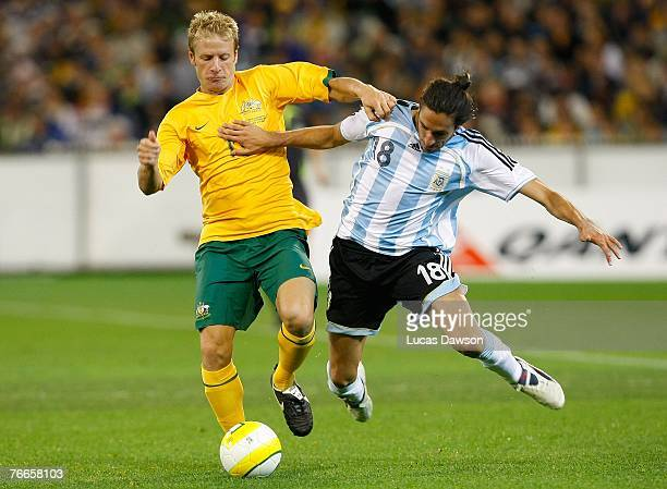 Gabriel Heinze of Argentina and Vincenzo Grella of Australia in action during the international friendly match between the Australian Socceroos and...