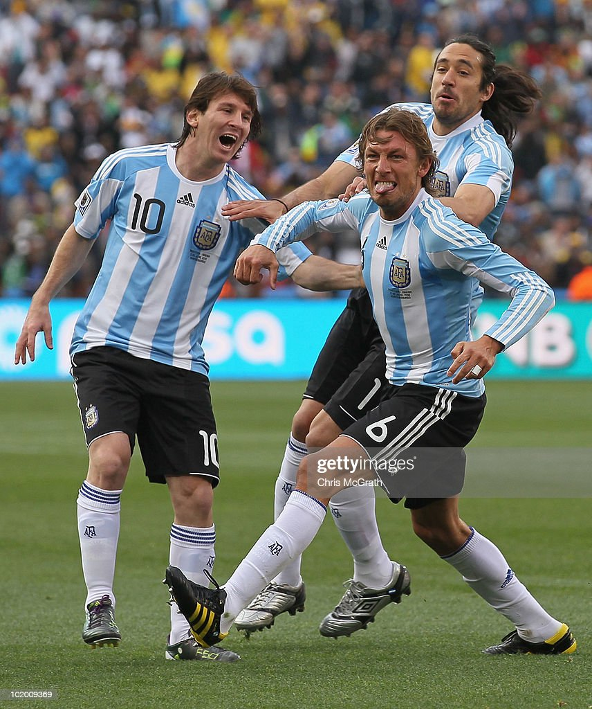 Gabriel Heinze (front) of Argentina celebrates with team mates Lionel Messi (L) and Jonas Gutierrez after he scored the opening goal during the 2010 FIFA World Cup South Africa Group B match between Argentina and Nigeria at Ellis Park Stadium on June 12, 2010 in Johannesburg, South Africa.