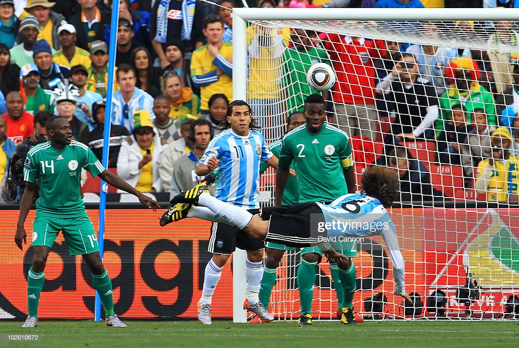 Gabriel Heinze of Argentina heads the ball into the top corner of the net to open the scoring during the 2010 FIFA World Cup South Africa Group B match between Argentina and Nigeria at Ellis Park Stadium on June 12, 2010 in Johannesburg, South Africa.