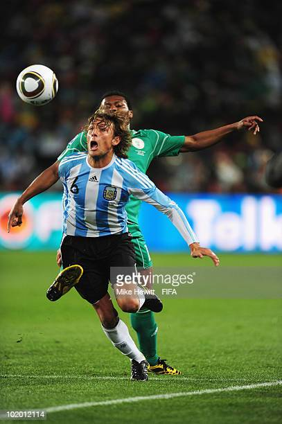 Gabriel Heinze of Argentina is challenged by Kalu Uche of Nigeria during the 2010 FIFA World Cup South Africa Group B match between Argentina and...