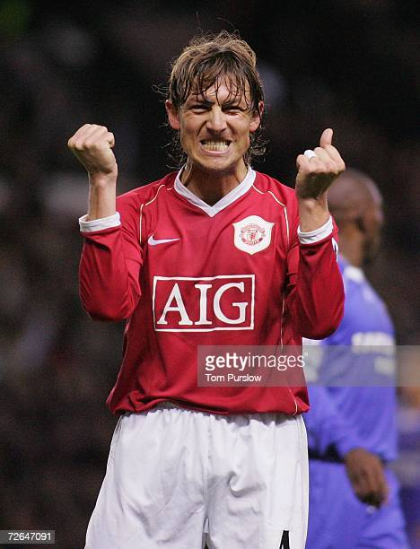 Gabriel Heinze of Manchester United celebrates Louis Saha scoring the first goal during the Barclays Premiership match between Manchester United and...