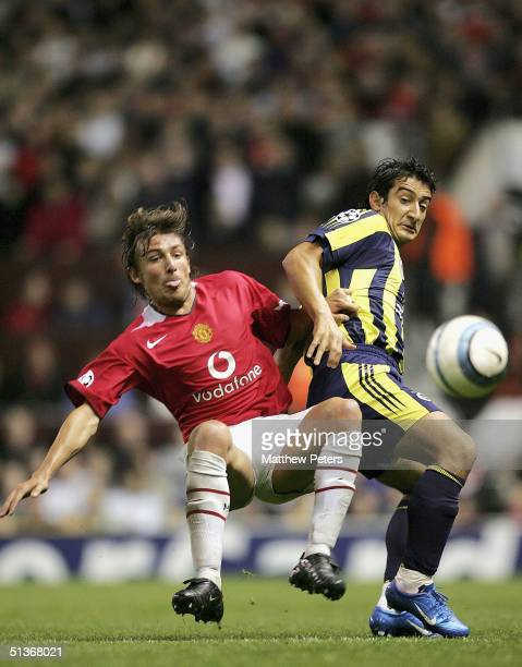Gabriel Heinze of Manchester United clashes with Serhat Akin of Fenerbahce during the UEFA Champions League match between Manchester United and...