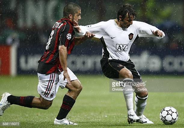 Gabriel Heinze of Manchester United is challenged by Ivan Gattuso of AC Milan during their Champions League second leg semifinal match in Milan's San...