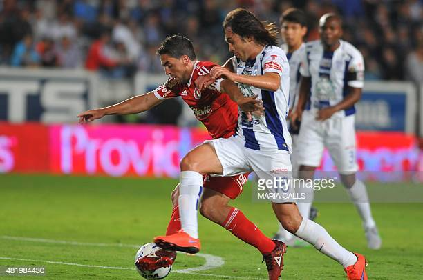 Gabriel Huache of Tijuana vies for the ball with Jose Martinez of Pachuca during their Mexican Apertura tournament football match at the Hidalgo...