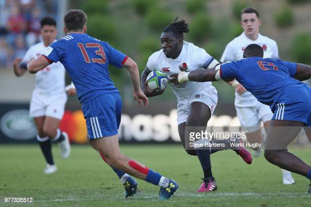 Gabriel Ibitoye of England is tackled by Demba Bamba and of France during the World Rugby Under 20 Championship Final between England and France at...