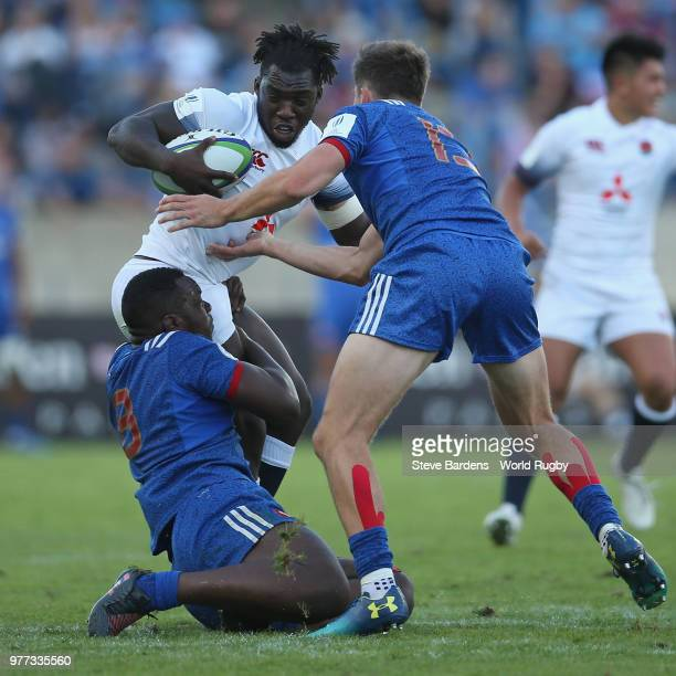 Gabriel Ibitoye of England is tackled by Demba Bamba and Pierre Louis Barassi of France during the World Rugby Under 20 Championship Final between...