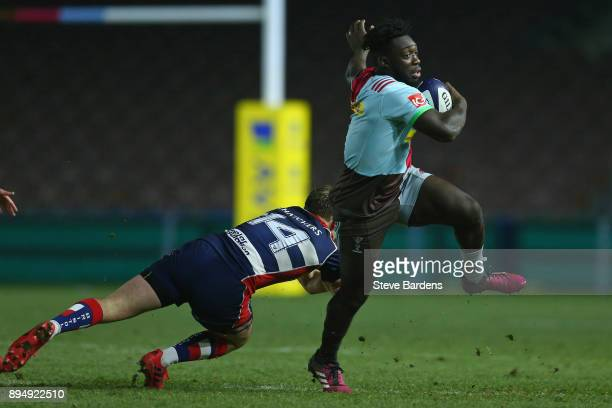 Gabriel Ibitoye of Harlequins A evades the tackle of Ali Greig of Bristol United during the Aviva A League match between Harlequins A and Bristol...