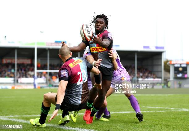 Gabriel Ibitoye of Harlequins collects the ball as she collides with his team mates Ross Chisholm during the semi-final of the Premiership Rugby Cup...