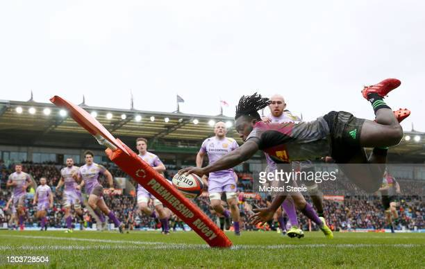 Gabriel Ibitoye of Harlequins dives over to score a try at Sandy Park on February 02, 2020 in Exeter, England.